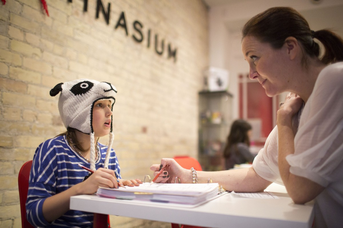 TORONTO, ON - DECEMBER 7 - Kate Murray (right), the owner of Mathnasium, works with Laura on an individual learning math plan on December 7, 2015. For story on new education survey that shows more parents than ever are hiring tutors for their kids. Mathnasium is a relatively new franchise in Toronto, helping kids with what most find the toughest subject. Carlos Osorio/Toronto Star