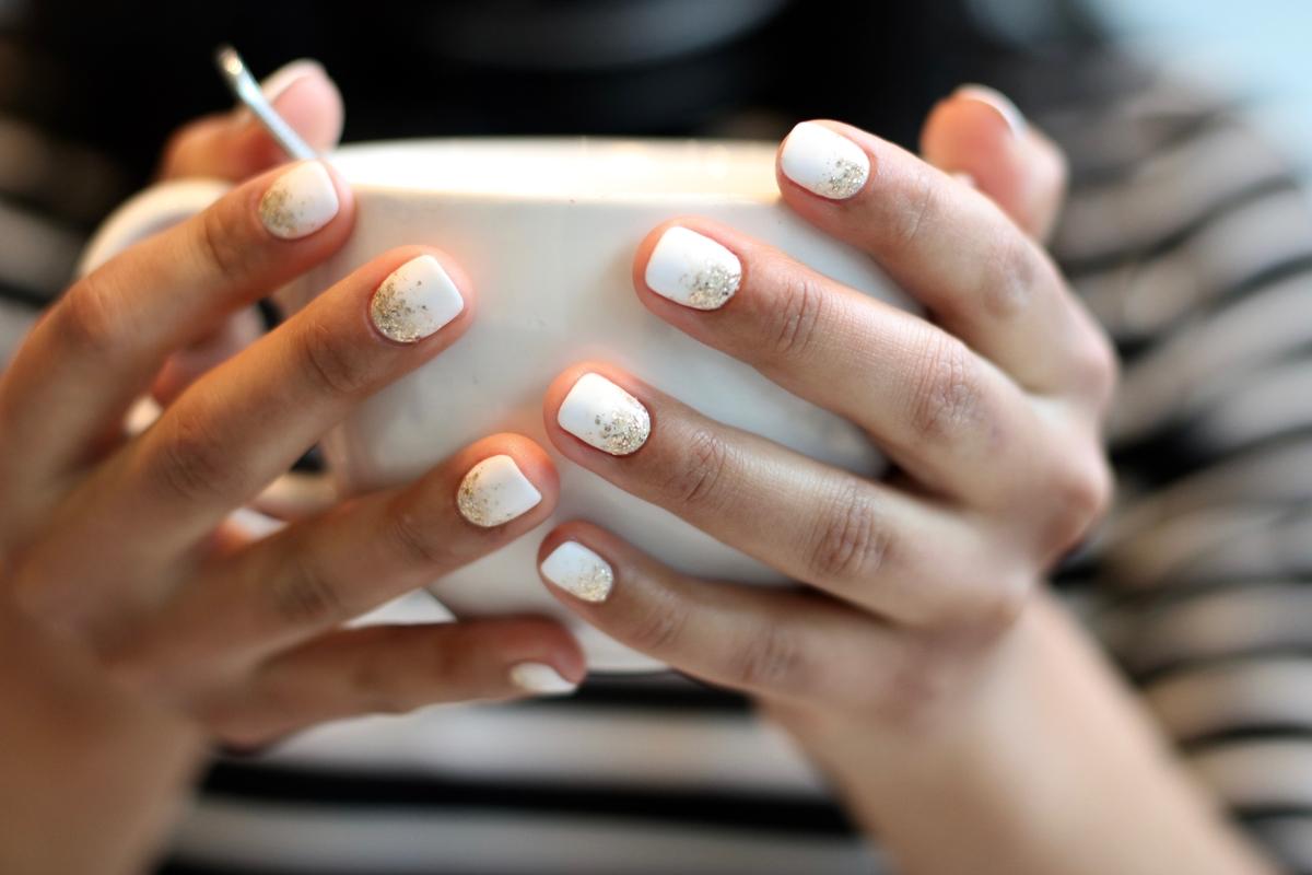 reverse french glitter manicure